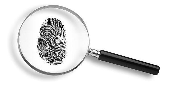 magnifying glass and thumb print on white background.  CRIME DETECTIVE THUMBPRINT MAGNIFYING GLASS FINGERPRINT FOTOLIA