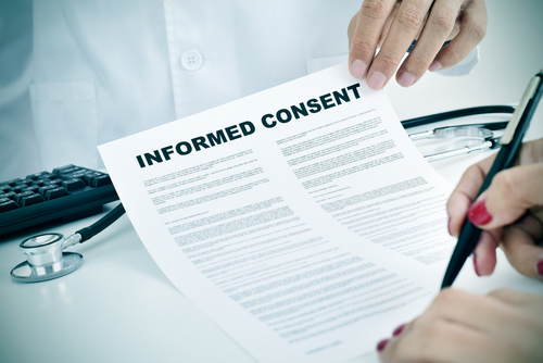 patient filling consent forms